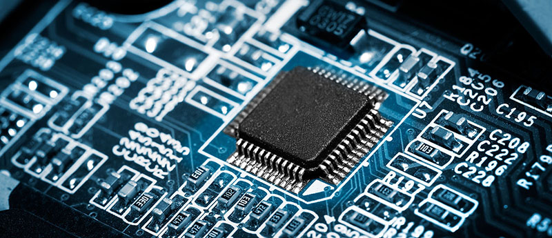Closeup of electronic circuit board with processor on blue tone. ** Note: Shallow depth of field